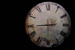 Uhr auf einem schwarzen Hintergrund Lizenzfreies Stockbild