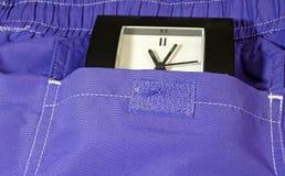 Uhr in der Tasche Stockfotografie