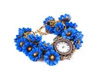 Uhr mit blauen Blumen Stockfotografie
