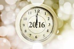 Uhr mit Nr. 2016 und bokeh Hintergrund Lizenzfreies Stockbild
