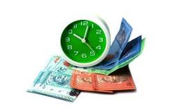 Uhr- und Malaysia-Banknoten Lizenzfreies Stockbild