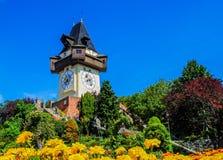 Uhrturm, klokketoren op heuvel Stock Foto