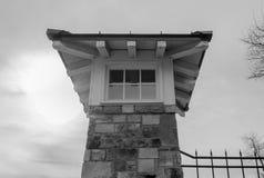 Uhrturm mit Sonne Lizenzfreies Stockfoto