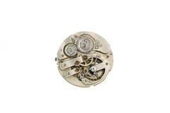 Uhrwerkdetails, Zahntriebe und Radmakronahaufnahme lokalisiert auf Weiß Lizenzfreie Stockfotos
