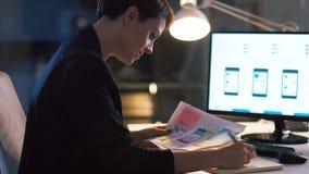 Ui designer working on interface at night office