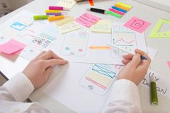 Ui Ux application designer working on desk royalty free stock photography