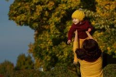 Family in sunny autumn park stock photos