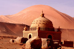 Uighur features a pavilion under the flame mountain Royalty Free Stock Photography