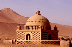 Uighur features a pavilion under the flame mountain Stock Images