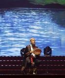 Uighur old man play xinjiang bongos ( hand drum ) Royalty Free Stock Images