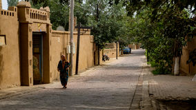 Uighur Old  women and Residential buildings in Korla Royalty Free Stock Photo