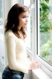 Uit het staren van het venster Royalty-vrije Stock Afbeeldingen