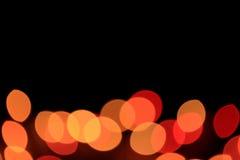 Uit Nadruk, Defocused, Bokeh, Vaag van Trillende Rode en Gele Kleurenlichten op Zwarte Achtergrond, met Vrije Ruimte voor Ontwerp Royalty-vrije Stock Afbeelding
