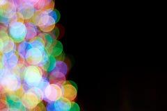 Uit Nadruk Vage Lichten op Zwarte Stock Afbeeldingen