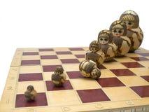 Uit orde - poppenschaakbord Stock Foto's