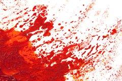 Uitbarsting of explosie in rode verf. Stock Foto's