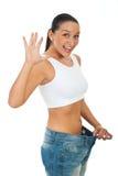 Uiterst gelukkige slanke vrouw die vooruitgang toont Stock Foto
