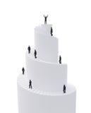Uiterst kleine mensen die spiraalvormige toren beklimmen Stock Foto's