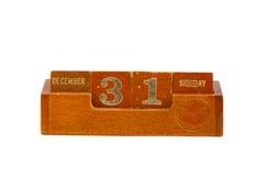 Uiterste datum 2012 jaar op uitstekende houten kalender Stock Afbeelding