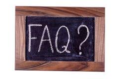 Uithangbord FAQ Geschreven in krijt Royalty-vrije Stock Foto's