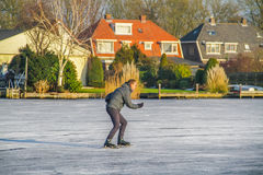 Uithoorn, Netherlands, February 4, 2017 - Ice Skaing on the frozen pond. Man is ice skaing on the small frozen pond in the netherlands Royalty Free Stock Photography