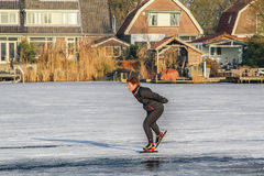 Uithoorn, Netherlands, February 4, 2017 - Ice Skaing on the frozen pond. Man is ice skaing on the small frozen pond Royalty Free Stock Photo
