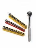 Uitrusting geïsoleerded moersleutels en mondstukken stock foto