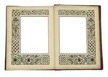 Uitstekend boek dat, met omlijstingen wordt geopend stock afbeeldingen