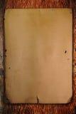 Uitstekend document op oud bruin hout Stock Afbeelding