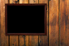 Uitstekend frame op houten muur Stock Afbeelding
