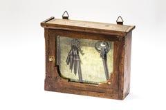 Uitstekend houten kabinet keychain Stock Foto's