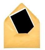 Uitstekend leeg fotoframe op envelop Stock Foto's