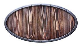Uitstekend ovaal houten uithangbord in gekrast metaalkader op klinknagels stock foto