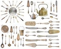 Uitstekend Tafelzilver, antieke die lepels, vorken, messen, gietlepel, cakeschoppen op ge?soleerde witte achtergrond worden ge?so royalty-vrije stock fotografie
