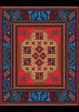Uitstekend tapijt met etnisch ornament in rode en blauwe kleuren Stock Fotografie