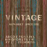 Uitstekend zegelalfabet en houten achtergrond Stock Afbeelding
