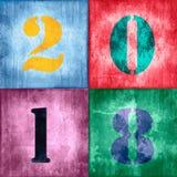 2018 uitstekende aantallen op grunge geweven kleurrijke achtergrond Stock Fotografie