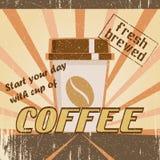 Uitstekende affiche met een koffiekop Royalty-vrije Stock Afbeeldingen