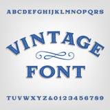 Uitstekende alfabetdoopvont Gekraste typeletters en getallen stock illustratie