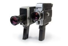 Uitstekende amateur mechanische en elektrische filmcamera's op witte achtergrond stock fotografie