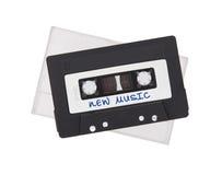 Uitstekende audiodiecassetteband, op witte achtergrond wordt geïsoleerd Stock Foto's