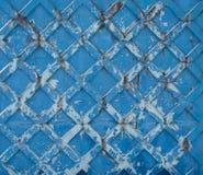 Uitstekende blauwe geschilderde concrete muur als achtergrond met een patroon van vierkanten royalty-vrije stock afbeeldingen