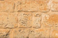 Uitstekende bruine blok gestalte gegeven van de steenmuur textuur als achtergrond, close-up stock fotografie