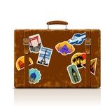 Uitstekende bruine threadbare koffer met inzameling van retro grung Stock Fotografie