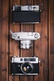 Uitstekende camera op houten achtergrond Stock Foto's