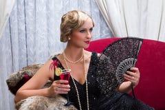 Uitstekende cocktail en ventilator royalty-vrije stock afbeeldingen
