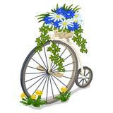 Uitstekende die fiets met bloemen wordt verfraaid Stock Fotografie