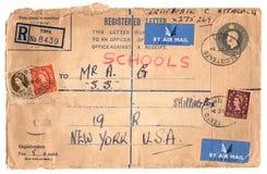Uitstekende envelop met zegels royalty-vrije stock afbeeldingen