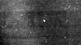 Uitstekende film als achtergrond op zwarte textuur met krassen stock fotografie