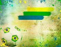 Uitstekende foto van voetbalbal en de kleuren van de vlag van Brazilië Stock Fotografie